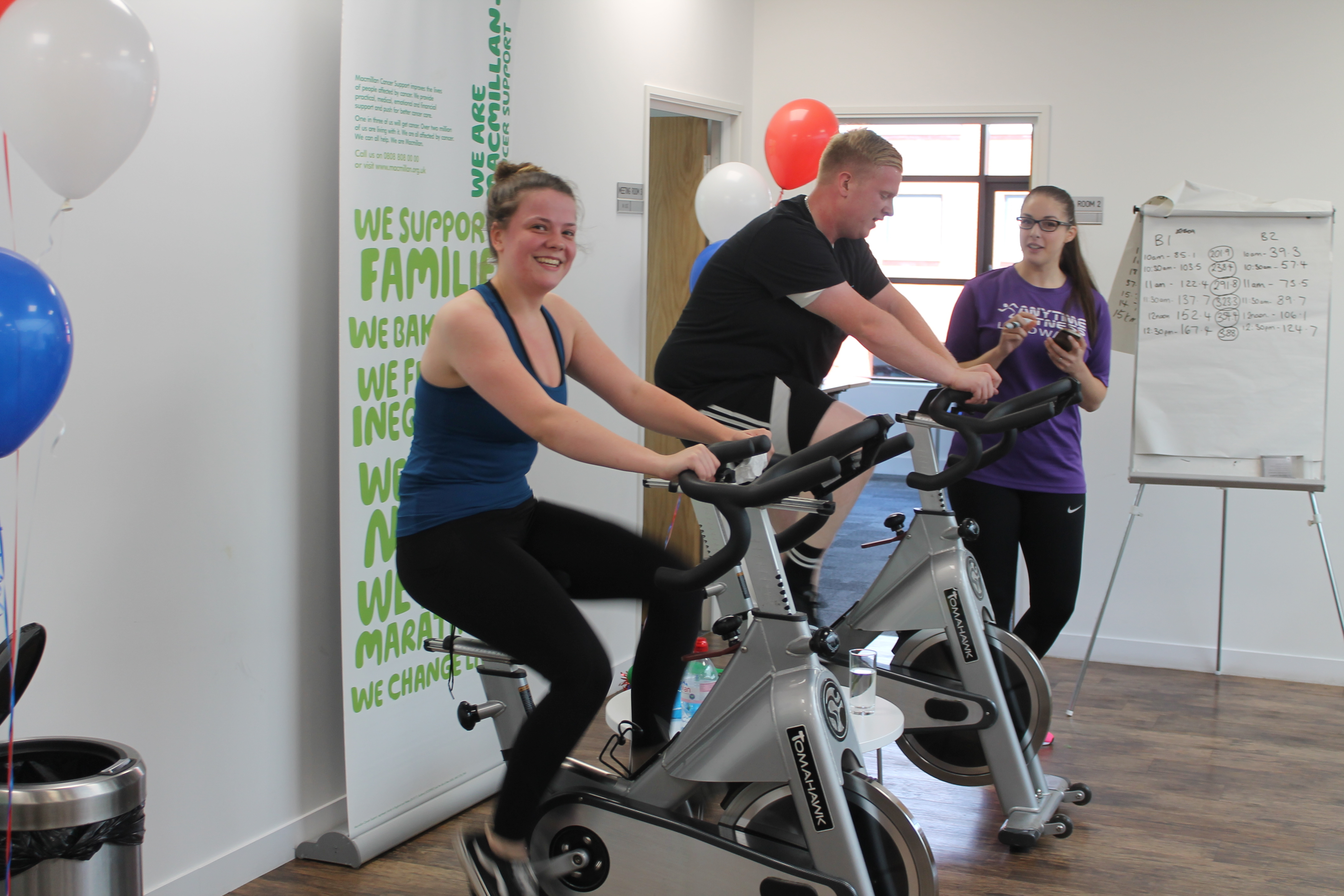 CliniMed staff riding on the training bikes